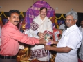 Presentation of bouquet by Thangella Trimurtulu to Ex Minister Sri pydikondala Manikyala Rao