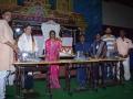 Sathguru Presenting Sewing Machines to Needies along with V.V.Lakshmi Narayana