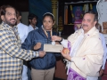 Donation of 5000 rupees check for International Boxing champian Miss Aruna by U.A.R.D.T
