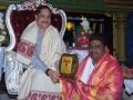 Sathguru presenting Memento to Mr. Banala Durga Prasad Sidhanthi