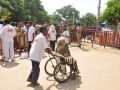 Peetham volunteers helping elderly people at Gowthami ghat