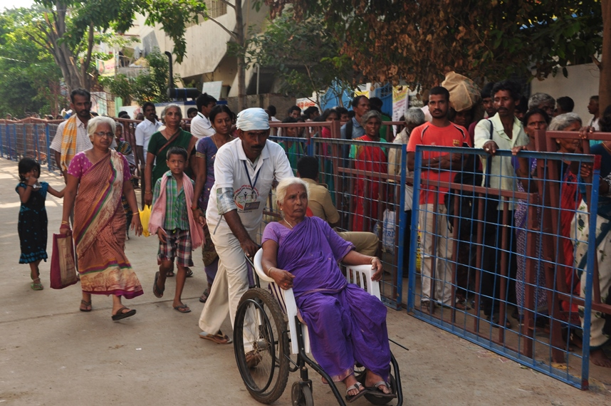3rd shift volunteer providing assistance to elderly women at Gowthami ghat