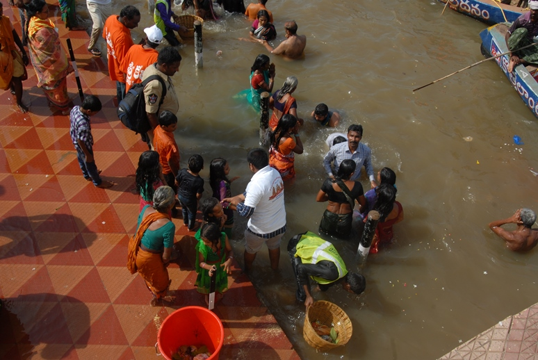 Peetham volunteers providing assistance at Gowthami ghat