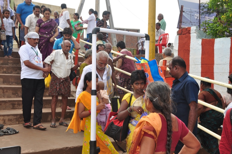 Volunteer providing assistance to elderly at Gowthami ghat , Rajahmundry on 20th Jul 2015, 7th day of Godavari Pushkaralu