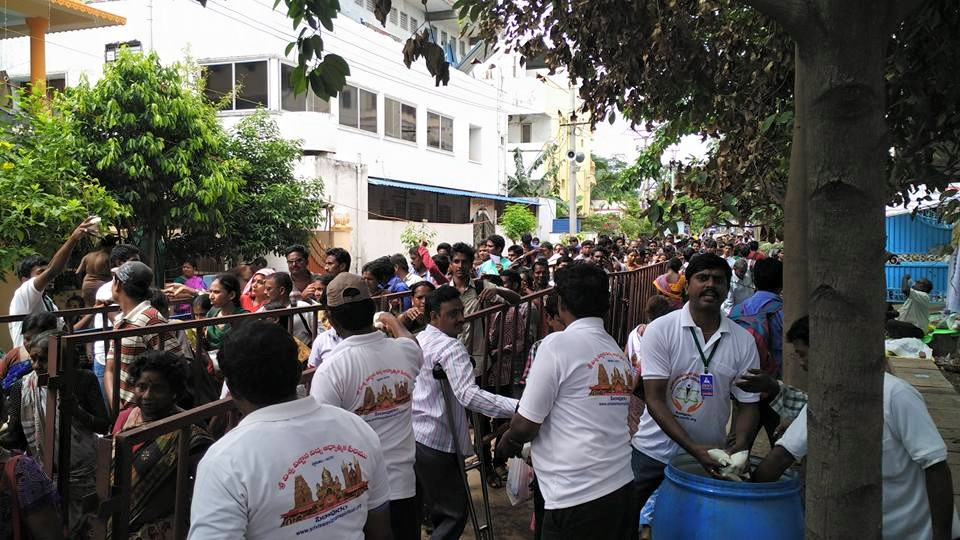Volunteers distributing butter milk to devotees arrived for Godavari Puskharalu 7th day, 20th Jul 2015 Gowthami ghat, Rajahmundry