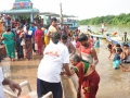 Volunteer providing assistance to elderly at Subbayamma ghat , Rajahmundry on 20th Jul 2015, 7th day of Godavari Pushkaralu