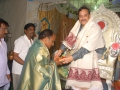 Sathguru Dr.Umar Alisha giving Prasadam and Tatwaznanam monthly magazine to Mr.Kishore Deputy Colector Nellore on  24 Jul 2015, 11th day of Godavari Pushkaralu at Rajahmundry Ashram