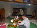 Volunteers making decoration Veena item ( stringed instrument) on 24 Jul 2015 at Rajahmundry Ashram, 12th day of Godavari Pushkaralu