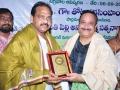 Dr.Umar Alisha ( current head of peetham) , great grand son of Kavisekhar Dr.Umar Alisha presenting memento to Sri. Thota Narasimham, M.P ( Kakinada)