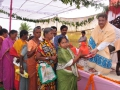 Distributing rice to poor people