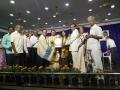"Dr.Kumar Rao receiving  the ""Sri Hussain Sha Kavi Puraskaaram"" from Sathguru Dr.Umar Alisha"