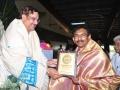 Sathguru Dr.Umar Alisha presenting memento to M.Ram Mohan rao  Muncipal commissioner of pithapuram.
