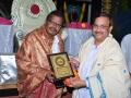Sathguru Dr.Umar Alisha presenting memento to Cheif Guest S.R.Bhallam, sahitivetha
