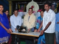 Sathguru Dr. Umar Alisha donating Sewing Machine