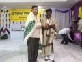 Sathguru Dr.Umar Alisha  giving prasadm to Sri Gattem manikyalarao,Kindness society president