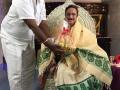 Sri Karibandi Rajagopalam presenting fruits to Sathguru Dr.Umar Alisha