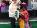 Sathguru Dr.Umar Alisha felicitating Smt. Pantham Rajani , Mayor ( Rajahmundry)