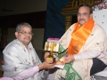 Sathguru Dr.Umar alisha presenting memento to Mr. Sri Vedula Sri Rama Sharma