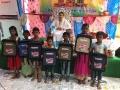 School bags disrtibution by Dr.Umar Alisha at RamarajuKandrika, Vadamalapeta Mandal, Chittoor district in Karthikamasa last schedule