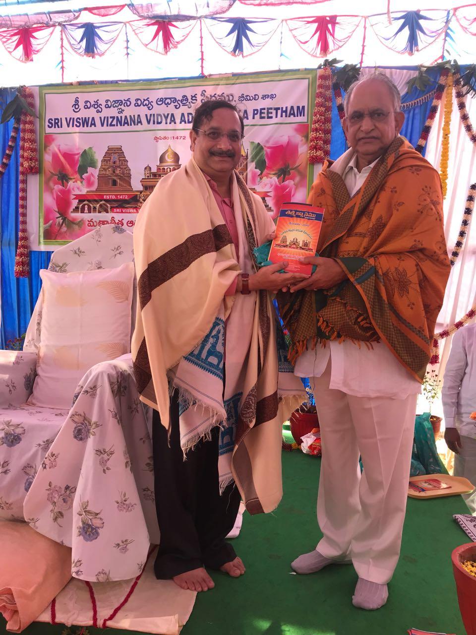 Sathguru Dr.Umar Alisha presenting Tatwajnanam magazine to Guest Sri MVVS Murthy garu, MLC (VSK) at Bheemili Ashram, 16th Anniversary Sabha