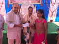 Cheques distribution to blind children at Sathguru Dr.Umar Alisha in  16th Anniversary Sabha at Bheemili Ashram