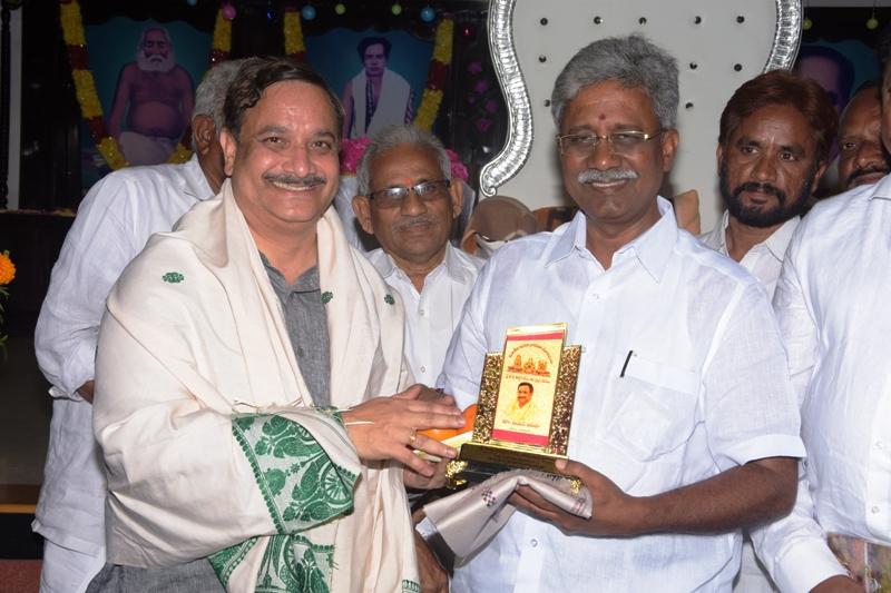 Dr. Umar Alisha Swamy honoring Mr. Paidikondala Manikyala Rao garu with memento.