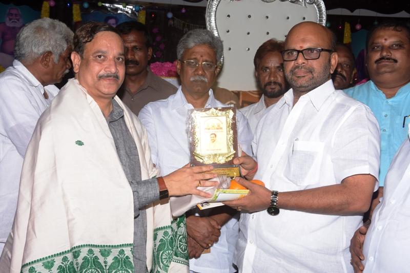 Dr. Umar Alisha Swamy honoring Sri. Varma Garu, Pithapuram MLA with memento.