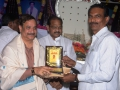 Presenting Memento to Pithapuram Municipal Commissioner Shri. M. Ram Mohan Garu by Sadthguru