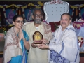 Sathguru presenting Memento to Mrs.Dr.G.Krishna Babu