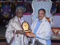 Sathguru honouring Pydikondala Manikyala Rao with Memento