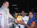 Sathguru presenting Memento to Mr & Mrs.Jyothula Nageeswara (Yoga Teacher)