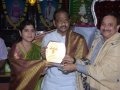 Sathguru presenting Memento to Mr & Mrs.Thota Narasimha