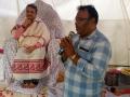 Sri Aaravapalli Ramu, MPDO Kovvuru delivering speech at Madhuru Ashram  on the occasion of Vysakhamasam